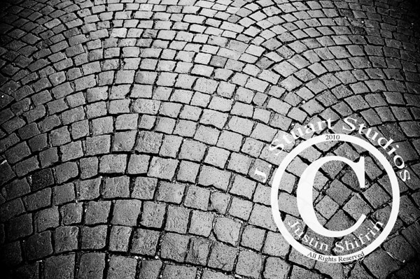 Prague Pattern  On a literally freezing day in Prague, Czech Republic my buddies and I walked through the streets, wandering, and searching for the city's secrets.  The old world charm of Prague is striking.  The cobblestones (pictured above) are just one of the many reminders of days gone by in this central European nation.  The narrow streets and dilapidated, yet well preserved edifices keep Prague in a semi-preserved state.  By the end of our visit to Prague I vowed to return, just in a warmer season!  Ago vita vos somnium (live the life you dream)