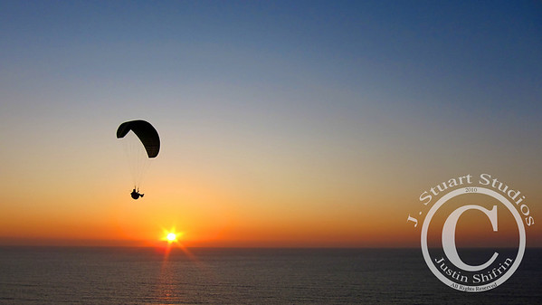 Sunshine Paraglider  With all of the sun and warm weather we have been having in San Diego, a sunset image of a paraglider above La Jolla, California is fitting.  Ago vita vos somnium (live the life you dream)