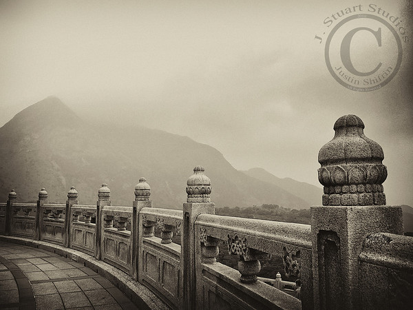 Tian Tan Vista  This photograph was taken at the Tian Tan Buddha on Lantau Island in Hong Kong.  What a serene setting!  This sepia-converted image from a Canon S90 leaves a timeless imprint.  Ago vita vos somnium (live the life you dream)